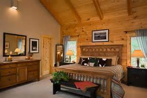 log home interior walls master bedroom with exposed heavy timber vaulted ceiling