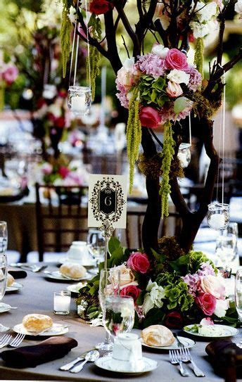 natural tree branches for centerpieces flowers peacock