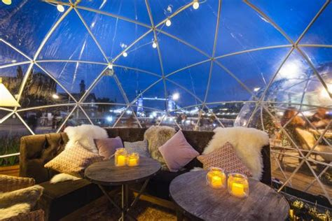 dine in a heated igloo on the banks of london s river giant igloos have sprung up near tower bridge london