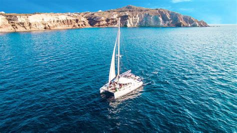 sunset sailing catamaran cruise santorini santorini catamaran sailing santorini photography