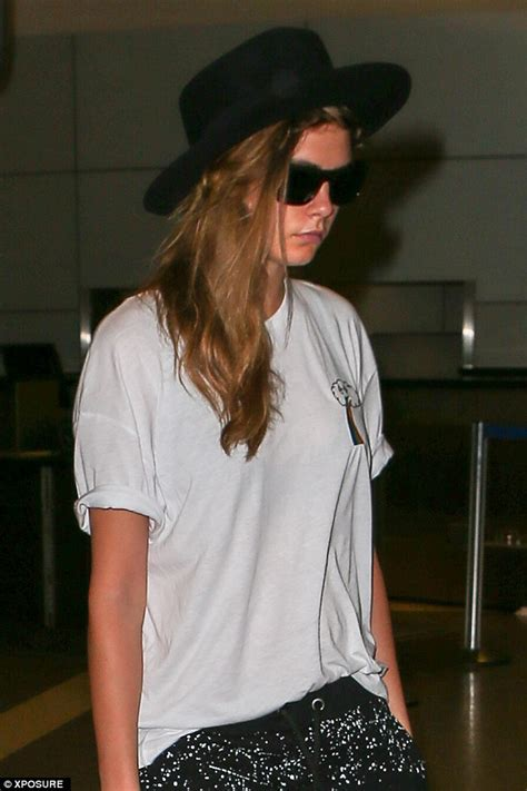 Fedorafashion Blouse No 08 cara delevingne wears positive t shirt as she jets to la