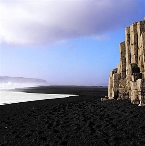 black sand beach in iceland cliff by the sea pinterest