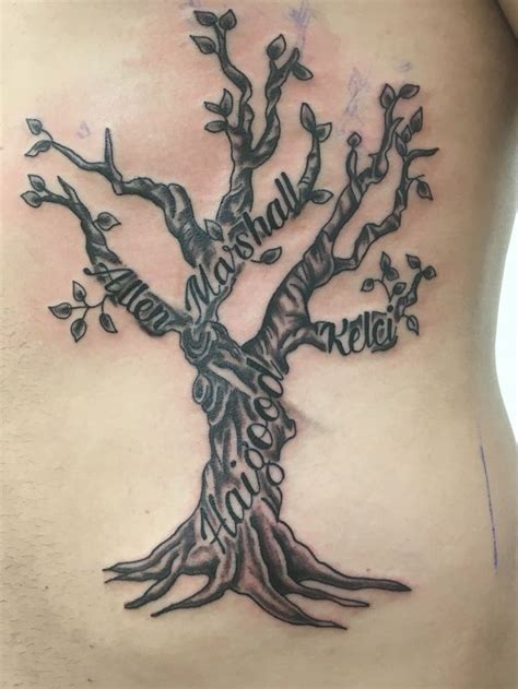 sohl family tree tattoo design done at altered images and piercing by