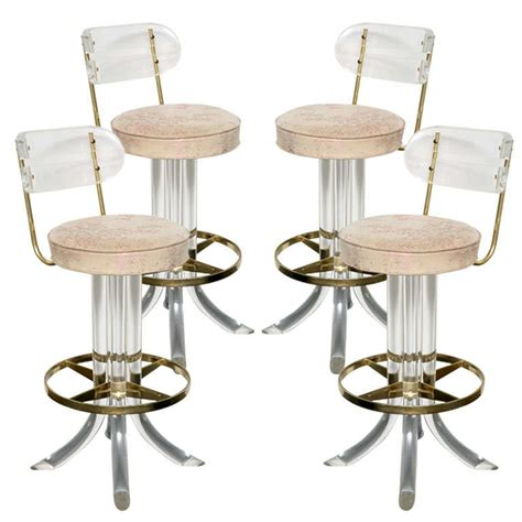 lucite counter chairs four lucite and brass swivel bar stools at 1stdibs