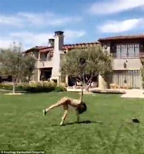backyard bootc kourtney kardashian shows off bikini bod in a leopard