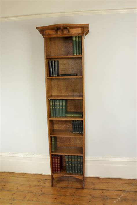 tall narrow oak bookcase arts and crafts tall narrow open oak bookcase antiques atlas
