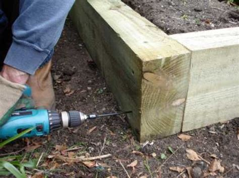 Laying Garden Sleepers by How To Build A Raised Bed With Railway Sleepers