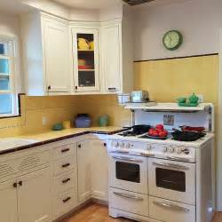 Gorgeous 1940s kitchen remodel featuring yellow tile with maroon trim