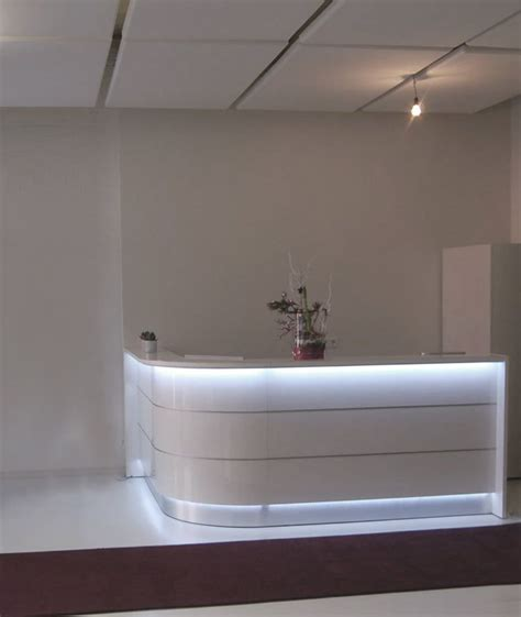 curved  rounded glossy white reception desk  led