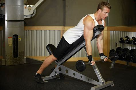 bicep curl with bench press barbell curls lying against an incline exercise guide and