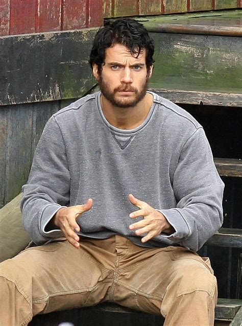 henry cavill superman beard henry cavill s clark kent rocks a beard in 12 new man of