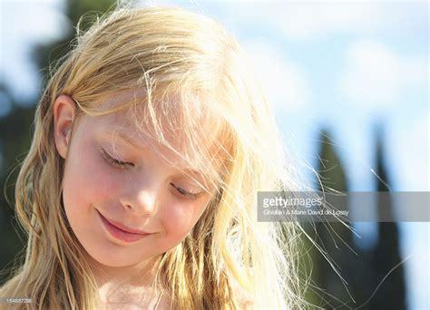 Girl looking down smiling moose