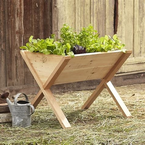 Wooden Vegetable Planters On Legs edible garden a veg wedge on legs gardenista