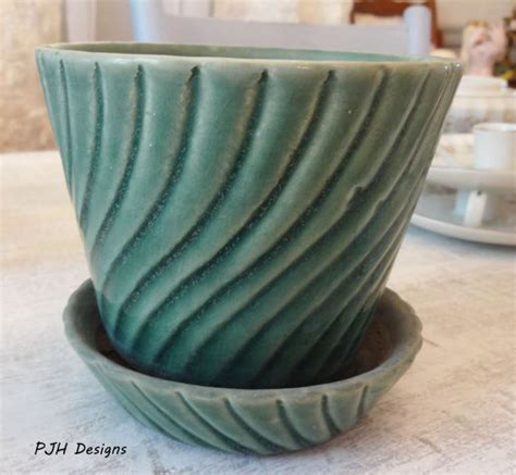 vintage brush mccoy pottery planter with saucer swirled green