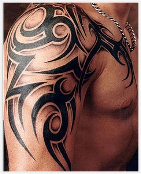 half chest tribal tattoo black ink tribal on half sleeve and chest