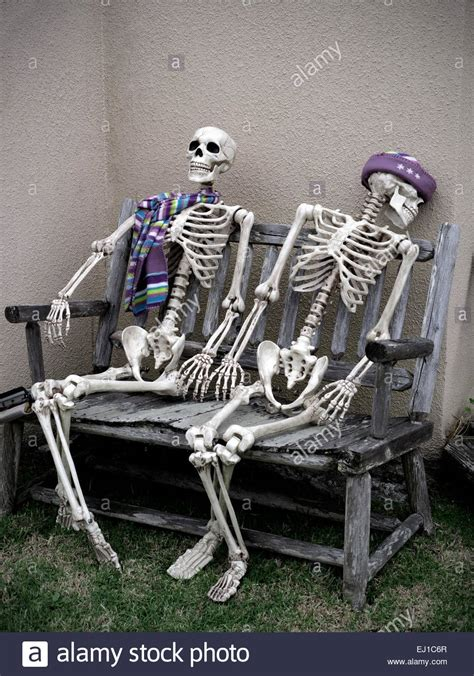 bench for two conceptual dark humour image of two skeletons sitting