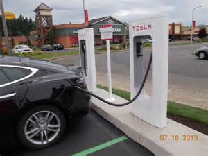 Tesla Electric Car How To Charge Tesla Unveils A Snake Like Robotic Charger That Can