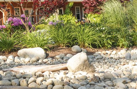 Rock Garden Bed Landscaping With River Rock River Rock Garden Ideas The Happy Housie