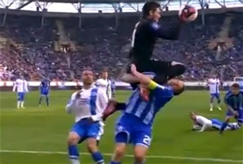 soccer player takes knee to the face, almost swallows his