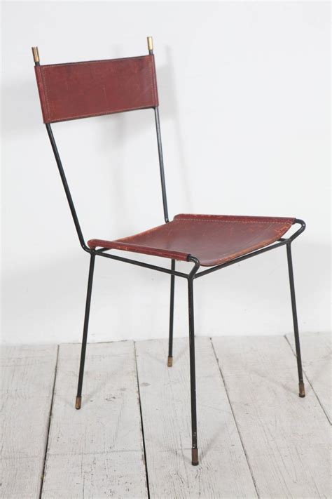 set of four italian leather and metal dining chairs with