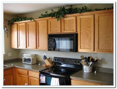 Decorating Kitchen Cabinet Tops Tips For Kitchen Counters Decor Home And Cabinet Reviews
