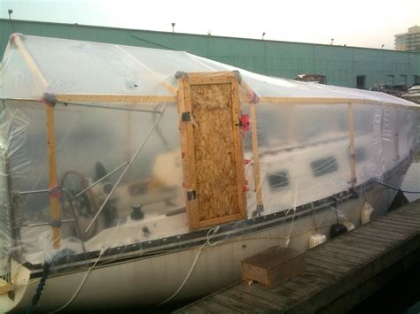 shrink wrap boat or not how to shrink wrap your boat for winter ragged sails