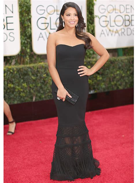 gina rodriguez offers her 2015 golden globes dress to a fan