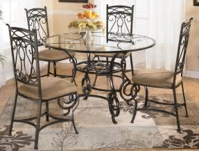 glass dining table with four chairs by