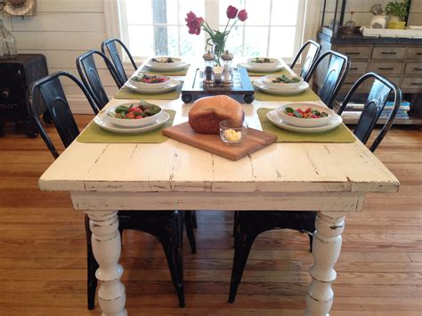 White Distressed Kitchen Table by This White Distressed Farm Table With The Black Metal