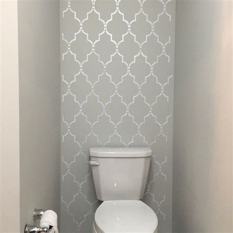 Bathroom Wall Stencil Ideas by A Diy Silver And Gray Stenciled Accent Wall In A Bathroom