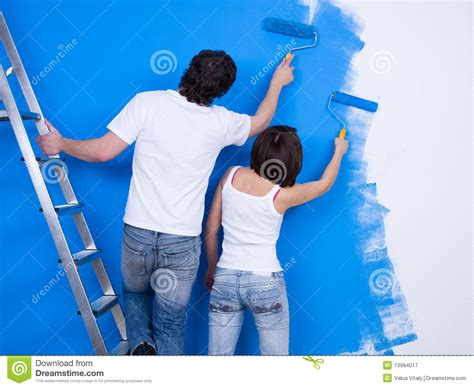 people painting couple of people painting the wall royalty free stock