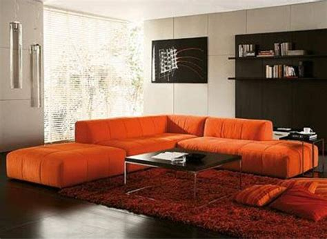 living room with orange couch salas con color naranja