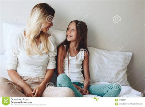 mom son bed mom with tween daughter stock photo image 70120627