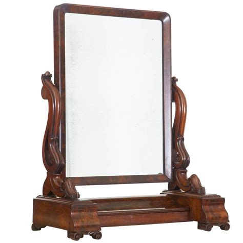 19th century early mahogany vanity mirror for