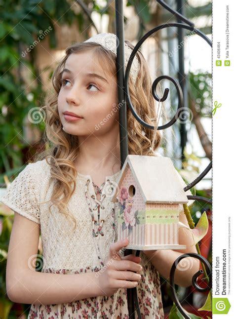 pimpandhost beautifullteens portrait of beautifull girl with nesting box stock photo