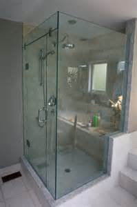 frameless corner shower with glass header support panel