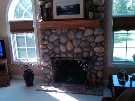 cobblestone fireplace a wood mantle for an existing stone fireplace