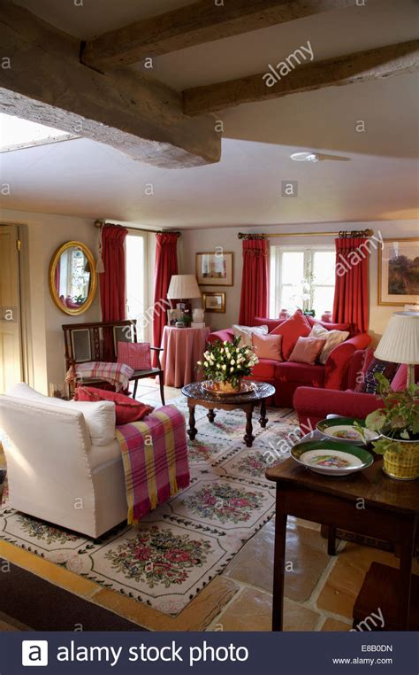 red and cream living room red checked throw on cream armchair in cosy cottage living
