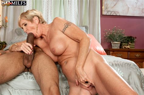 Good Looking Busty Blonde milf Having sex With Chocolate Skinned Young Dude