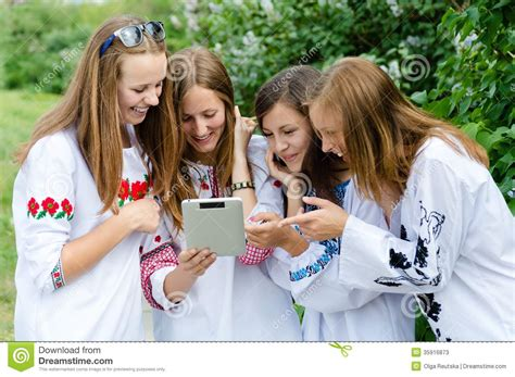 young ukrainian teens four pretty happy teen girl friends and tablet computer