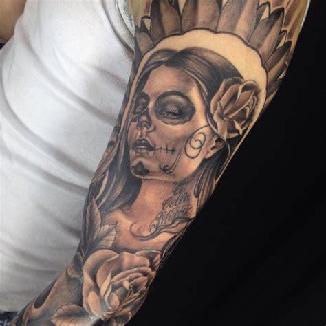 black and grey catrina tattoo on left full sleeve