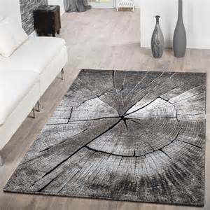 moderner teppich teppich modern edel mit konturenschnitt baumstamm natur