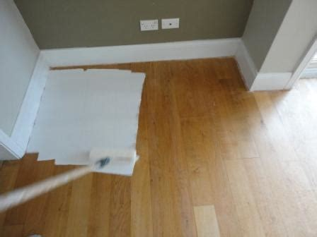 can you paint vinyl coated wood molding how to paint a wooden floor white before and after