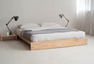 White Bed Frame Without Headboard White Brown Bedding Set Between Black Wooden Side Table Also Ls In The Gray Wall Room