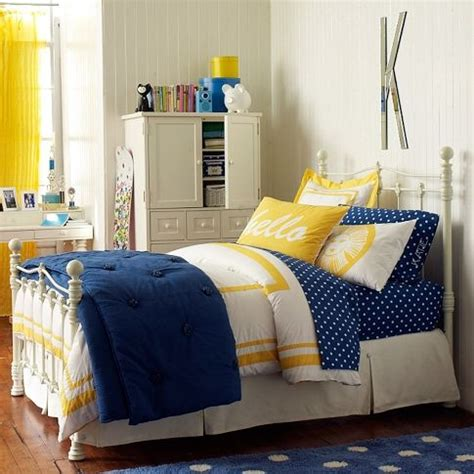 navy bedding with yellow accents for the home