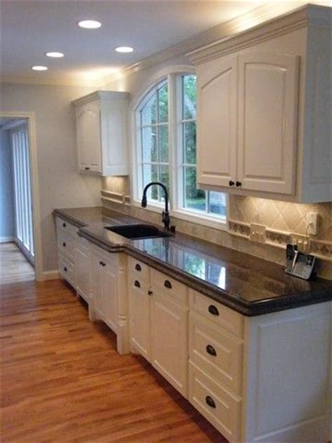 Brown Kitchen Cabinets With Granite Countertops by Tropic Brown Granite Countertops Home Ideas