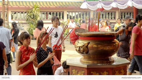 hd stock video footage two women flaunt tradition and two thai women praying on the eve of chinese new year