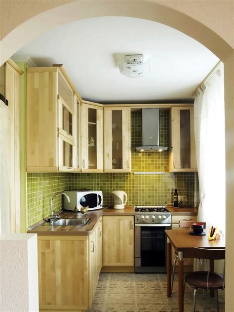 small designer kitchen downsized appliances light wood cabinetry and a large open