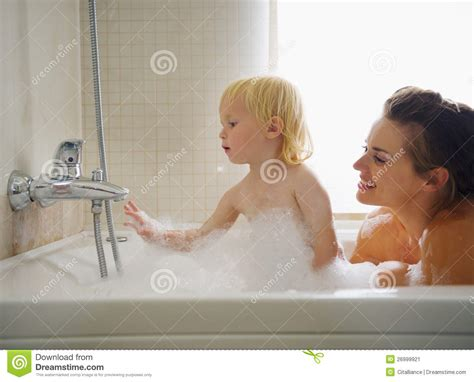 mom in bathtub mother and baby playing in bathtub stock image image