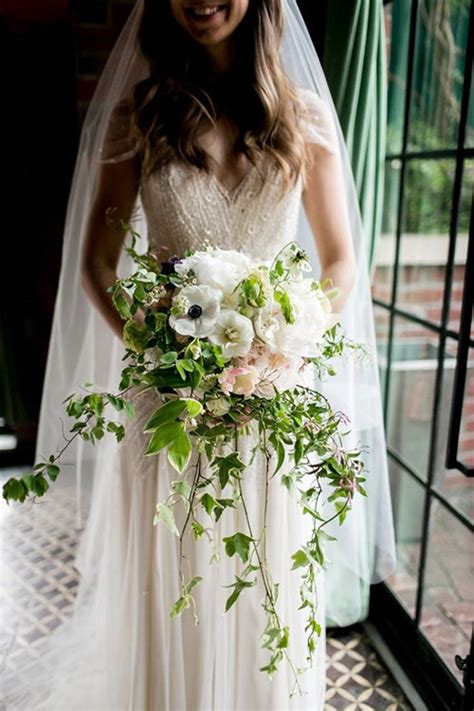 Garden Wedding Hairstyles For Guests by Cascading Wedding Bouquets Brides